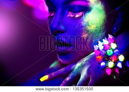 Fashion model woman in neon light, portrait of beautiful model girl with fluorescent powder make-up,