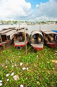 Boats In A Harbor In The Mekong Delta, Can Tho, Vietnam
