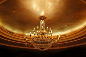 stock photo of flambeau  - elegant crystal ceiling lamp - JPG