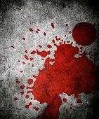 red paint splash on grunge background