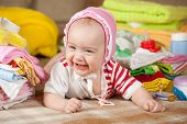 stock photo of babygro  - baby girl with stacked of children - JPG