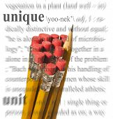 Ein Foto von einer Gruppe von Bleistifte mit einem gegenüber entfernt steht ein einzigartiges Thema