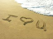A photo of I Love You written in the sand