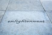 A photo of a sidewalk etched with enlightenment