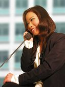 A photo of a business woman on the phone
