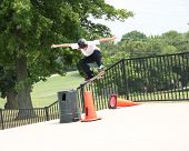 Skateboarder Jumping Cone