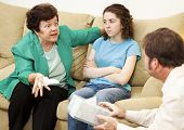 Angry mother complains about her teenage daughter in family therapy.