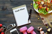 Top View On Wooden Table With Salad, Dumbbells, Measure Tape, Smartphone And  Notebook With Diet Pla poster