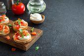 Italian Bruschetta With Chopped Tomatoes, Basil, Mozzarella Cheese And Balsamic Vinegar. Fresh Homem poster