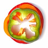 Orange Green And Red Pepper Slices On White Background