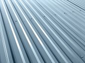 Corrugated Grey Metal Sheets With Rivets On Roof Of Industrial Building poster