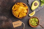 Mexican Food Concept. Nachos - Yellow Corn Totopos Chips With Guacamole, Top View, Copy Space. poster