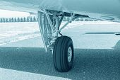 Wheel Of Airplane. Close Up Of Aircraft Wheel On Runway. Plane Wheel, Jet Plane, Blue Colored poster