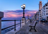 Bari Seafront. Colorful Amazing Sunset. Coastline And City View. Twilight Purple And Blue Sky. poster