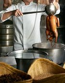 Chef Preparing Of Peking Roast Duck In The Kitchen Of Restaurant. Peking Duck Is A Famous Duck Dish  poster