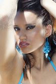 Sensual Tanned Beach Woman With Intense Eyes Makeup. A Provocative Woman With A Look Attractive, Fem poster