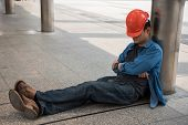 Lazy Engineer With Orange Helmet Sleeping At Construction Site In Modern City. Engineering Man Take  poster