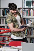 Muscular College Student In A Library poster