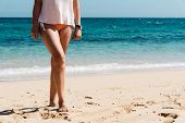Beach Vacation Travel, Woman Legs Closeup Standing On White Sand Relaxing In Beach Wearing Bikini Sw poster