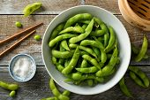 Fresh Steamed Edamame Sprinkled With Sea Salt On A Rustic Tabletop. poster