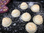 Homemade Coconut Macaroons Coconut Meringue Cookies In Baking Pan Paper, Close Up. Coconut Macaroons poster