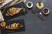 Restaurant Food - Whole Grilled Dorado And Sea Bass On Dark Restaurant Table, Mediterranean Cuisine, poster