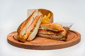 Club Sandwich. Club Sandwich And Fries On Wooden Board poster