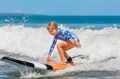 Happy Baby Girl - Young Surfer Ride On Surfboard With Fun On Sea Waves. Active Family Lifestyle, Kid poster