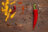 Постер, плакат: Spices Red Pepper On A Dark Wooden Background Background With Spices spices Top View Close Up