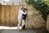 Sensual Couple Hiding Out Of Sun With Ancient Rocky Wall And Old Fence On Background. Couple In Love poster