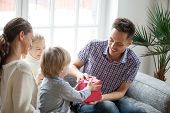 Little Son Presenting Gift For Dad, Cute Boy Holding Box Making Daddy Surprise Present, Kids Congrat poster