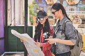 Travel And Relaxing Concepts, Tourists Are Taking Photos In The City. Asian Girls Are Happily Travel poster