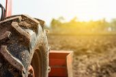 Tractor Tire On Field. Agriculture Tractor Plowing Field. poster