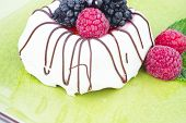 Black and White chocolate with blackberries on green plate