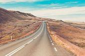 Highway Through Icelandic Landscape Under A Blue Summer Sky poster