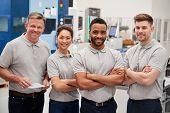 Portrait Of Engineering Team On Factory Floor Of Busy Workshop poster