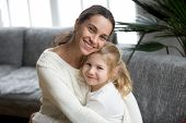 Portrait Of Happy Loving Single Mother Hugging Cute Little Daughter, Smiling Young Woman Embracing P poster