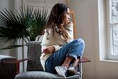 Sad Thoughtful Teen Girl Sits On Chair Feels Depressed, Offended Or Lonely, Upset Young Woman Suffer poster