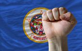 Us State Flag Of Minnesota With Hard Fist In Front Of It Symbolizing Power
