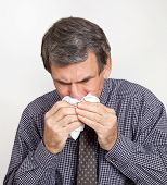 Man with Nosebleed or Cold Wiping Nose