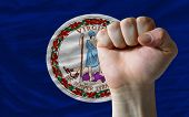 Us State Flag Of Virginia With Hard Fist In Front Of It Symbolizing Power
