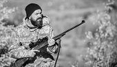 Bearded Hunter Spend Leisure Hunting. Focus And Concentration Of Experienced Hunter. Regulation Of H poster