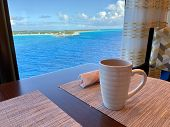 Coffee On A Table Aboard A Cruise Ship Overlooking The Beautiful Turquoise Waters Of The Bahamas. poster