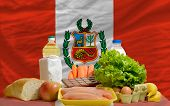 Basic Food Groceries In Front Of Peru National Flag