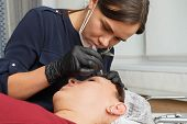 The Master Removes Tweezers With Eyebrow Hair After The Procedure. Permanent Eyebrow Makeup Procedur poster