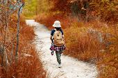 Student Asian Girl And Traveler With Backpack Adventure Holding Map To Find Directions In The Autumn poster