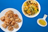 Dumplings On A White Plate Against A Blue Background. Dumplings Meat In Tomato Sauce With Vegetable  poster
