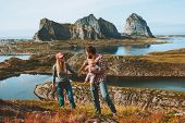 Family Couple With Child Hiking Outdoor Travel Adventure Vacations Mother And Father With Infant Bab poster