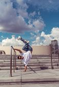 Young Active Dancer Stands On One Arm, Sport Man, In City Summer, Break-dancer Pose, Hip-hop Movemen poster