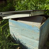 Empty Beeehive With Removed Top Used Like A Storage For Beekeeping Stuff poster